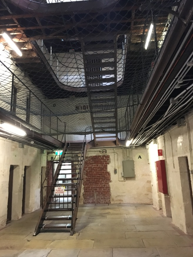 The main hall of the men's prison. Notice the lovely 'suicide net' to catch jumpers.