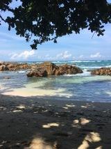 The rocks that break the waves on Secret Beach.