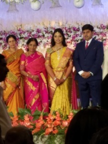 The bride and groom flanked by family.