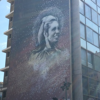 A famous mural of the Lebanese pop star Sabah. She is depicted without a headscarf, and that's something.