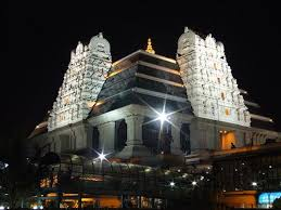 A view of the Bangalore ISKCON temple at night.
