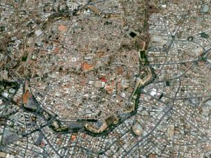 An arial view of the city of Nicosia. You can see the walls of the old cit and the Green Line down the middle.