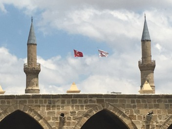 The flags of Turkey (left) and TRNC (right) flying over an Ottoman market.