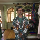 Jeff looking like a grim Russian in his ikat outfit.