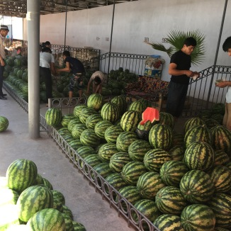 Produce at the Margilan Bazaar. Is it possible to eat this much watermelon??