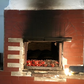They bake a traditional bread in a wood fire oven.