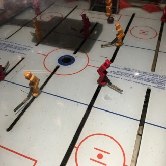 This game was freakishly hard. It was a hockey version of foosball, but since you have to deal with 3-D (not 2-D) its really damn hard.
