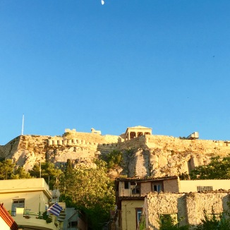 The daytime moon over the Acropolis.